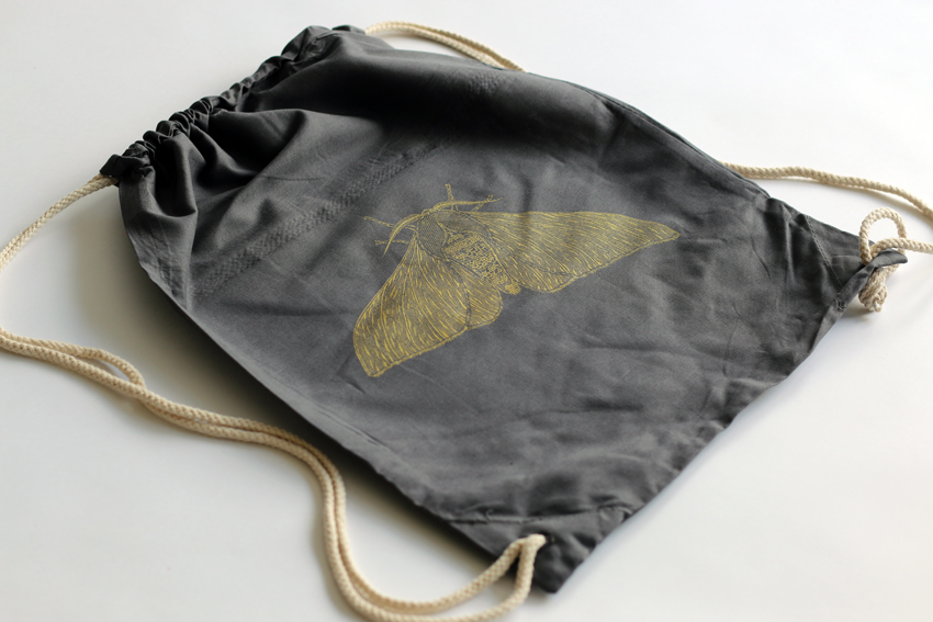 Grey gymsac with golden Peppered moth (GS003)